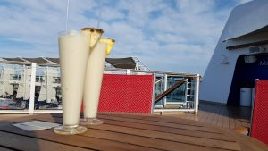 Virgin Coladas by the pool on Celebrity Eclipse on boarding day